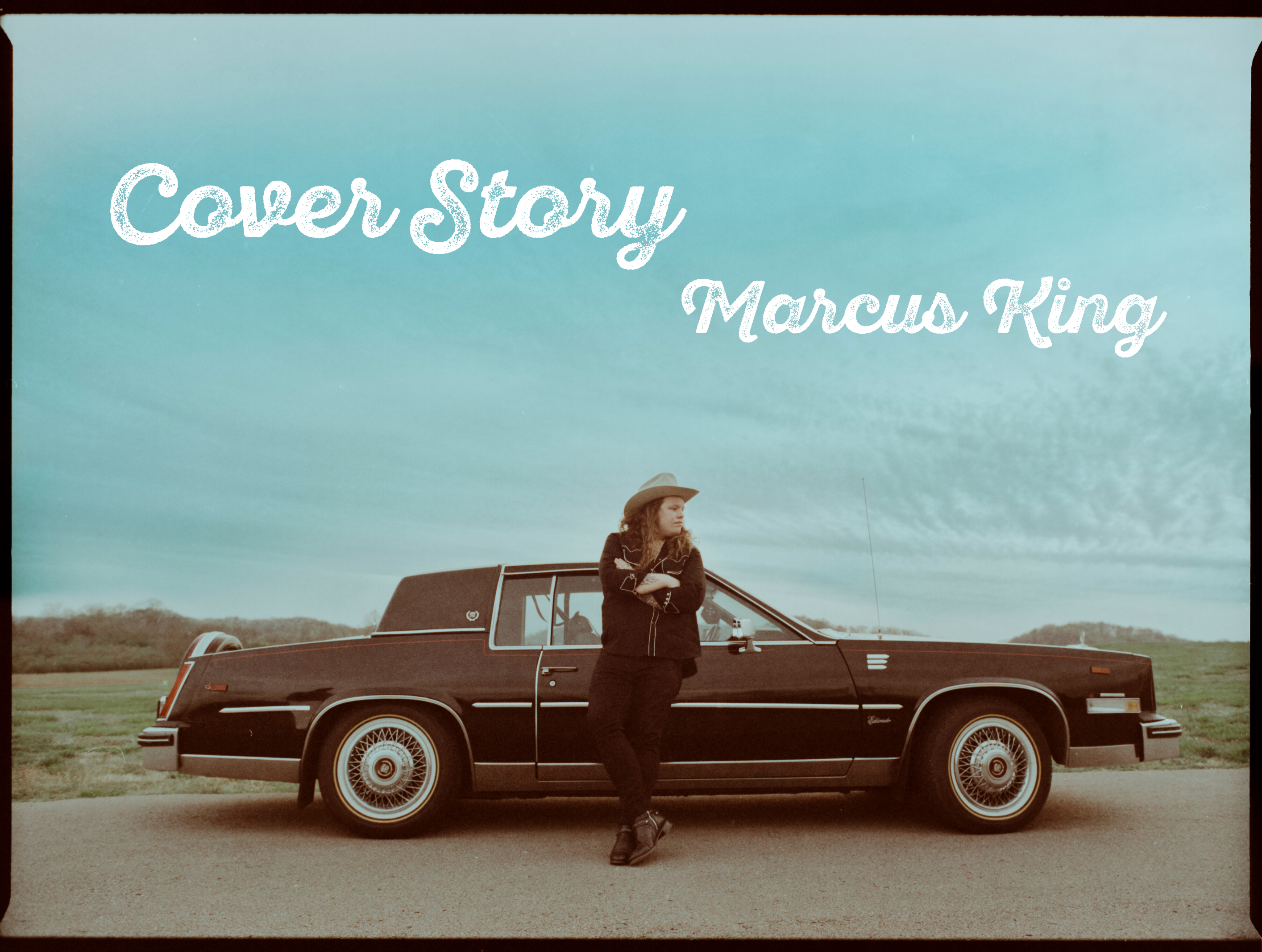 """Marcus King, wearing a cowboy hat and leaning against a classic Cadillac. Image reads: """"Cover Story, Marcus King"""""""