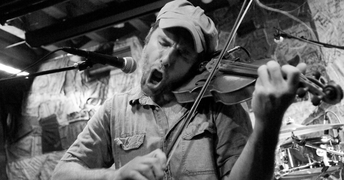 Possess by Paul James (Konrad Wert) playing fiddle in black and white