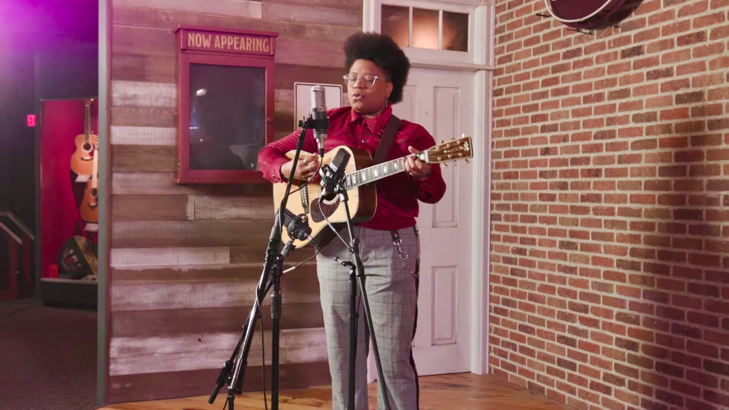 Amythyst Kiah performs in front of two condenser microphones with a 1942 Martin D-45
